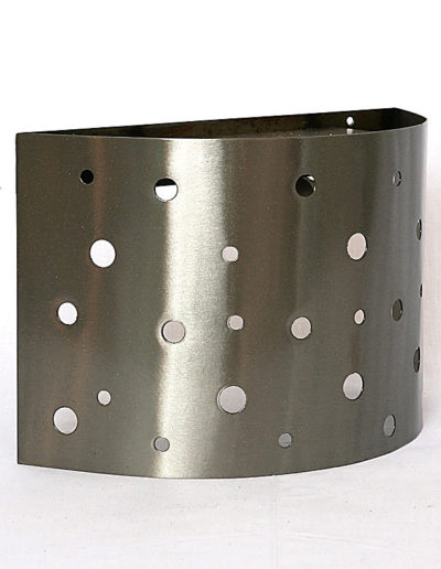 Apliqué metal hoyos pulido